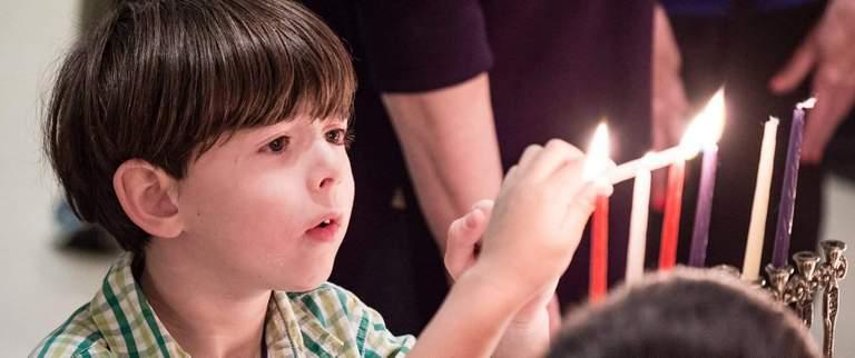 Jewish children and Jewish families celebrating holidays